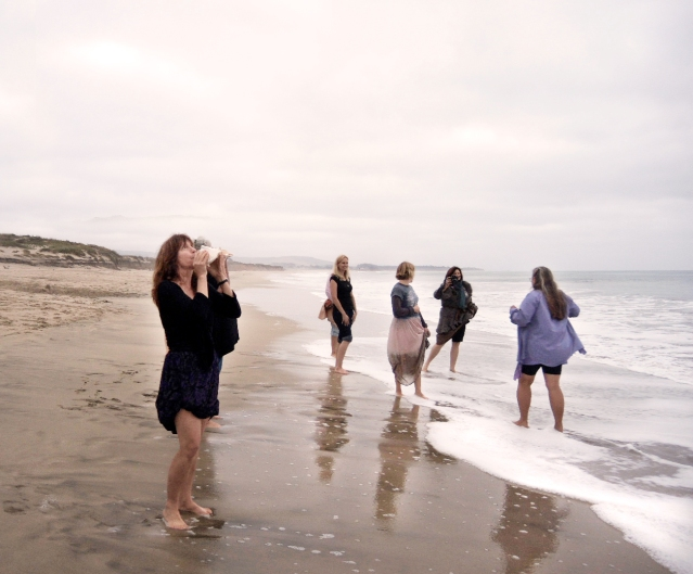 Bold women wading in the water to call upon the spirit of Freyja